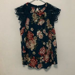navy shirt with floral pattern and lace sleeves